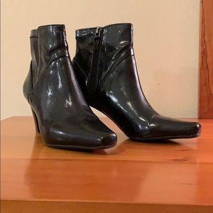 Franco Sarto black heeled booties. Side zip.